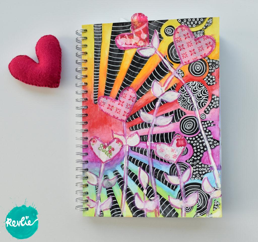 REV it up Dare 22: art journaling video met neocolor crayons, een stencil en stof!